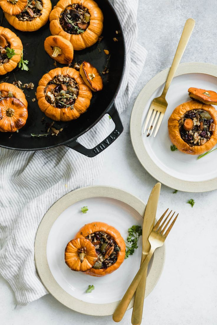 Mini wild rice stuffed pumpkins full of fall vegetables, pecans, and cranberries. #healthyeating #cleaneating