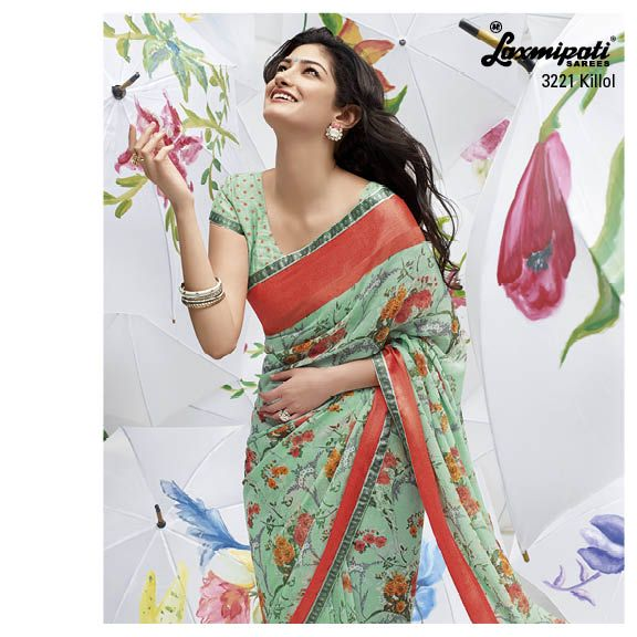 Elegant floral printed light green saree with polka doted blouse piece is a mesmerizing design.