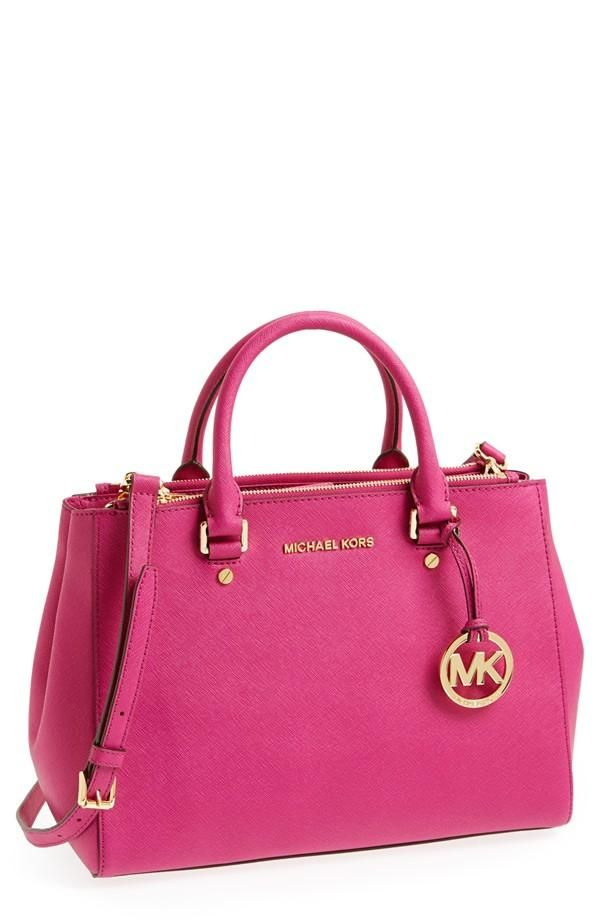 Pink! Arm candy from Michael Kors.