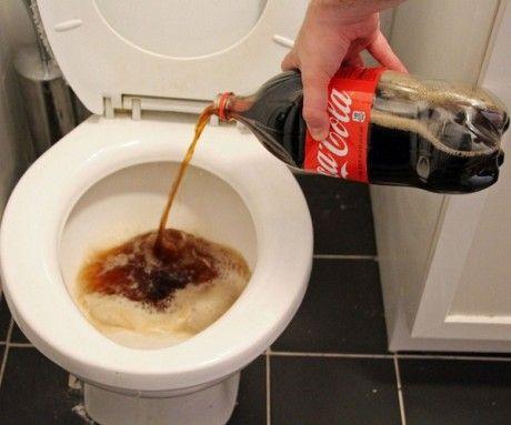 Clean toilet bowl with Coca Cola