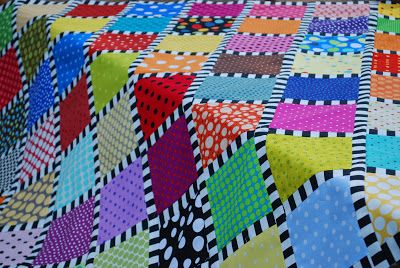 Polka dot blocks and striped sashing -- it adds such a zing to the quilt.
