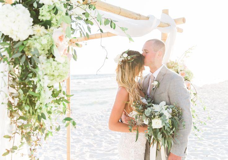 Beach wedding arbor flowers boho chic . All white and greenery