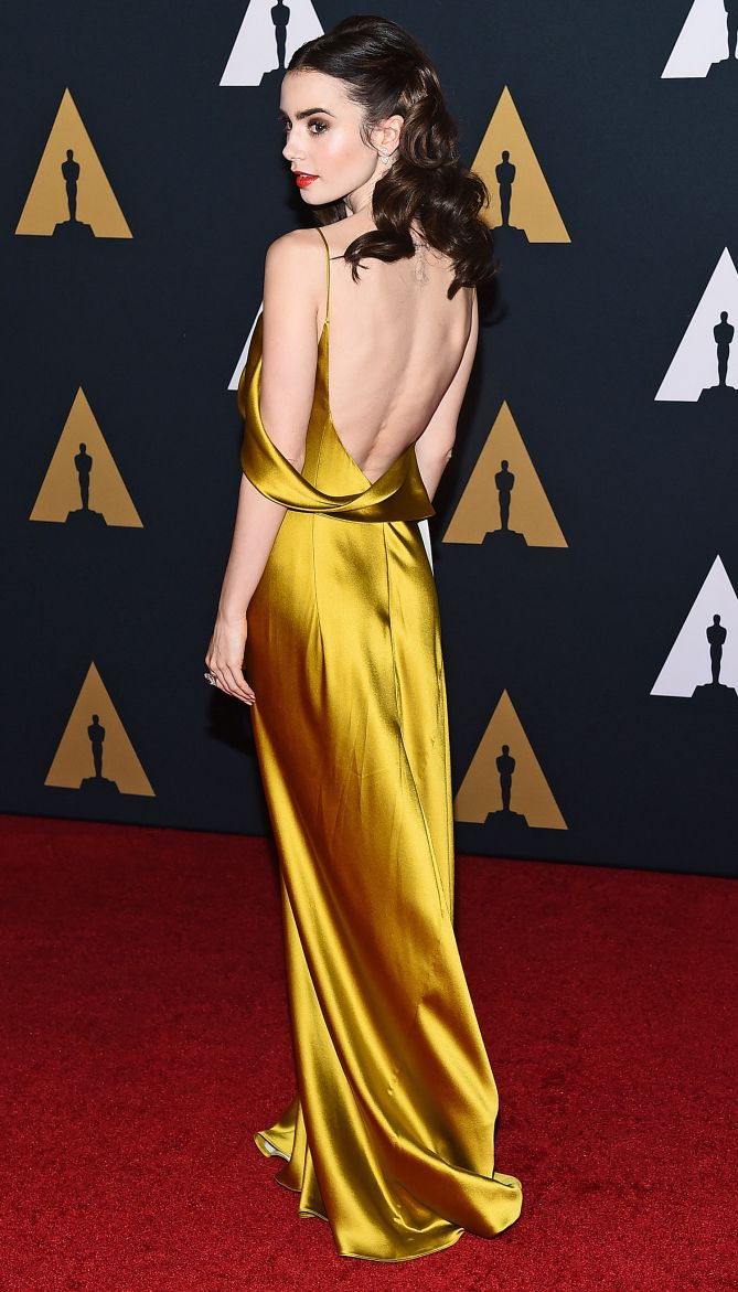 Lily Collins in a yellow satin Amanda Wakeley dress - click ahead to see more dresses from the back