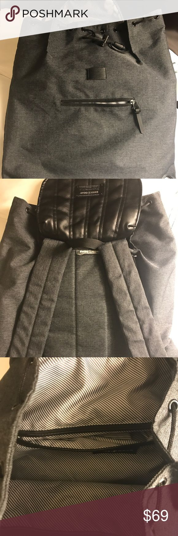 Gray Swiss Gear Alpine Bag Gently used. Leather and cloth with plenty of pockets and zippers. Comfortable straps and holds about as much as a standard backpack. SwissGear Bags Backpacks