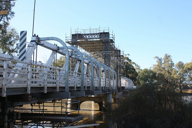 Swan Hill Bridge is a timber truss, steel lift span bridge across the Murray River at Swan Hill.    The Victorian railway reached Swan Hill in 1889 and the need for a bridge was more and more recognised. A lift-span bridge, allowing the passage of the river-boats, which were still numerous in this area, was planned in 1895 and opened in 1896.