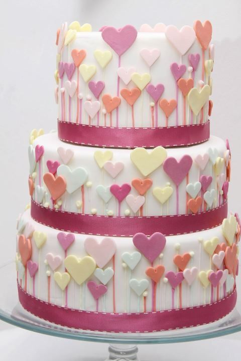 Pastel Hearts Tiered cake with pastel fondant hearts! Simple design but so fun! http://sussle.org/t/Heart_%28symbol%29