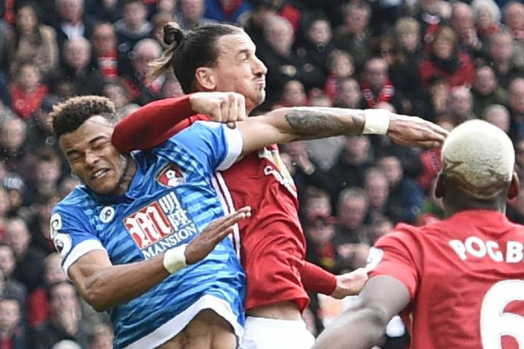 Manchester United's Swedish striker Zlatan Ibrahimovic (2L) clashes in the air with Bournemouth's English defender Tyrone Mings (L) during the English Premier League football match between Manchester United and Bournemouth at Old Trafford in Manchester, north west England, on March 4, 2017. / AFP PHOTO / Oli SCARFF / RESTRICTED TO EDITORIAL USE. No use with unauthorized audio, video, data, fixture lists, club/league logos or 'live' services. Online in-match use limited to 75 images, no…