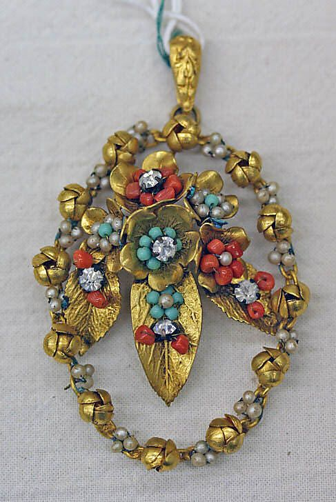 Gold floral pendant with rhinestones, pearls, and coral and turquoise-colored beads, by Chanel, French, 1930s.
