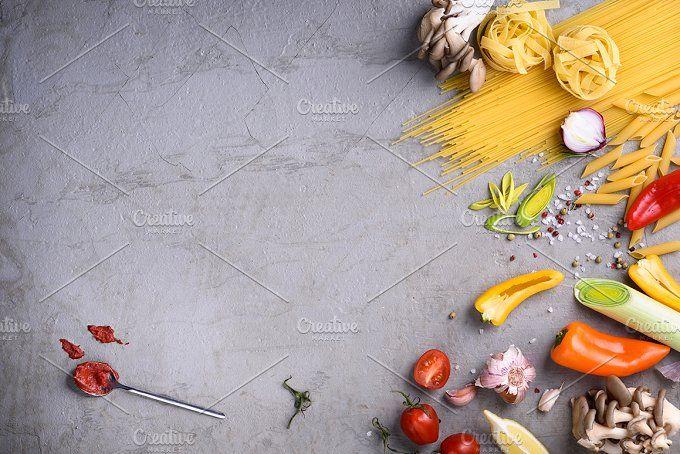 Raw pasta with ingredients by Iuliia Leonova on @creativemarket