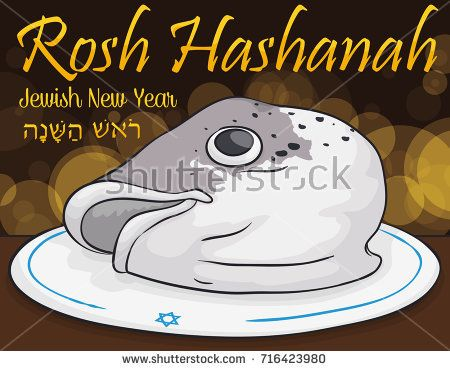 Traditional fish head dish for Rosh Hashanah (written in Hebrew) or Jewish New Year celebration symbolizing the new beginnings with bokeh effect in the background.