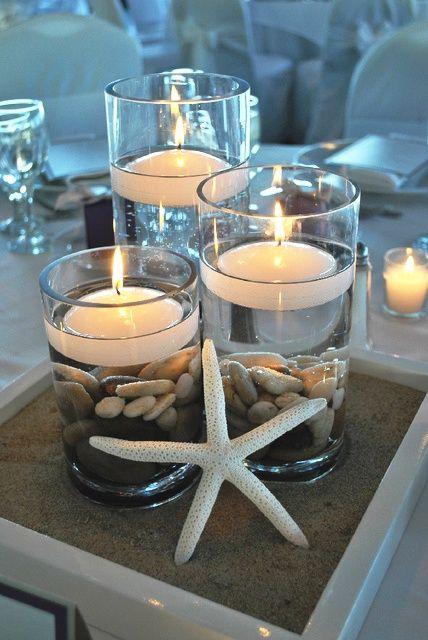 bonitos centros estilo marinero. Tarro de cristal, piedrecitas, velas flotantes y una estrella de mar♥