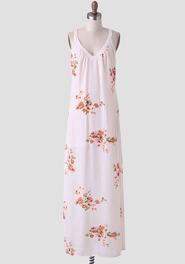 Perfect for an outdoor party, this stunning beige maxi dress is adorned with a lovely floral print and flattering V-cut neckline. Accented with an alluring sheer lace panel at the back, this beau...