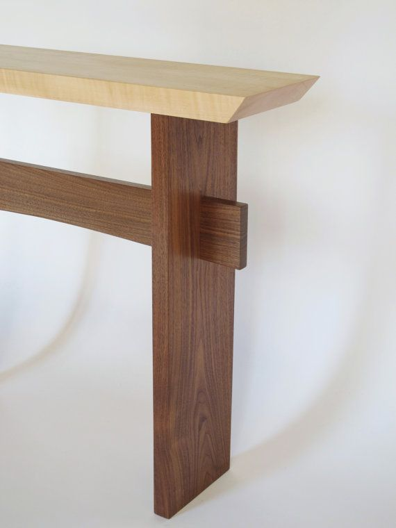 This narrow table design is perfect for urban living spaces. An artistic choice for your console table, entryway table or side table. The gentle curve of the stretcher adds unique mid century modern elegance.  -Striking tiger maple grain seems to shimmer in the light -Minimalist modern zen style lines -Velvet touch, hand-rubbed finish -Wipe clean with soft, dry cloth  THIS TABLE IS MADE TO ORDER  Approximately 40x9x32. ------------------------------------------  Need the measurements…