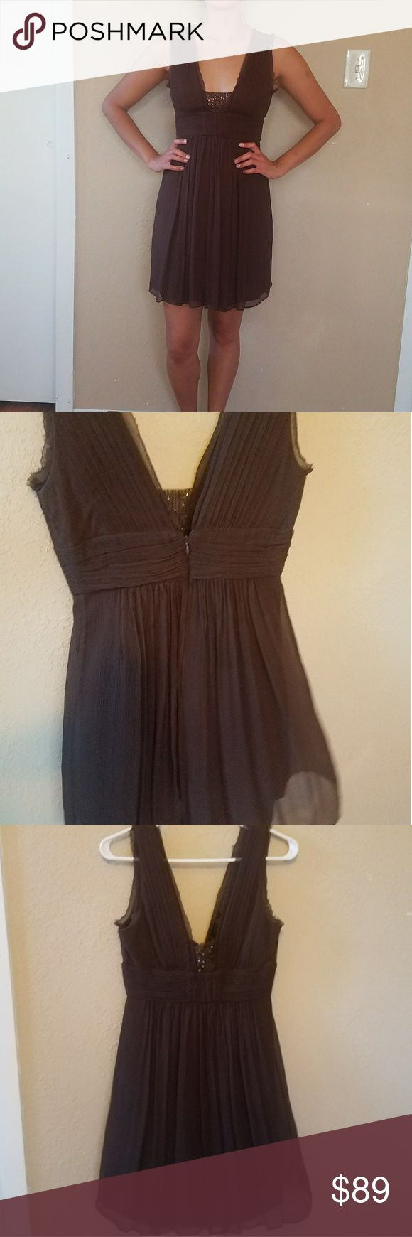 BCBG MaxAzria Chocolate Brown cocktail dress BCBG MaxAzria Chocolate Brown cocktail dress- worn once, new condition. The silk dress has beautful beading and hem details all along the top.  There is pretty draping, folds, poly lining,  low back.  I would keep this dress,  but it is too tight.  No stretch,  fitted, back zipper closure. BCBGMaxAzria Dresses Midi