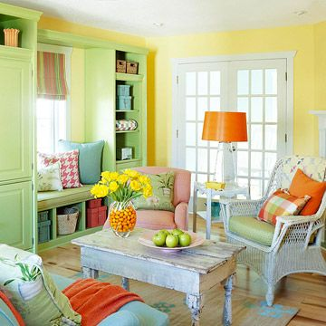 "Airy Spring Switch  Create a casual living room that sings ""spring,"" brimming with juicy citrus colors. Add brightly colored vases, spunky patterned pillows, a painted jute rug, and flea market finds to your space for a fresh feel without spending a fortune."