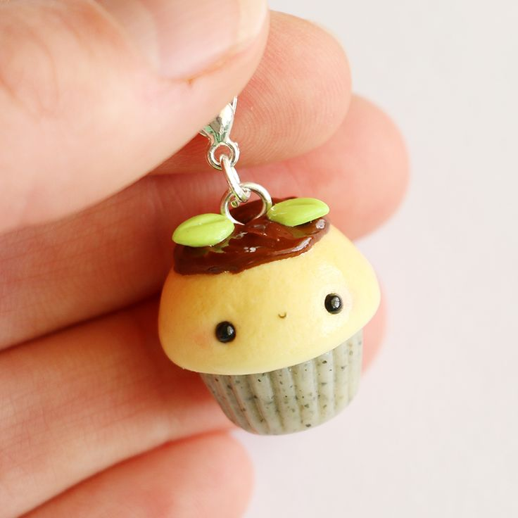 This+Garden+Cupcake+charm+is+the+perfect+accessory+to+add+a+touch+of+cuteness+to+your+life!+  It+is+made+out+of+strong+oven+bake+polymer+clay.+The+eyepin+(finding)+is+secured+with+super+glue+to+ensure+durability.  It+was+glazed+with+a+high+quality+gloss+varnish+for+protection+and+extra+shine....