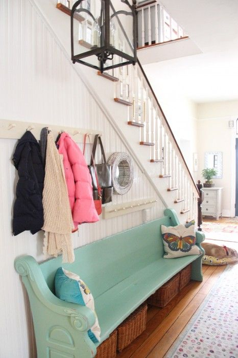Love the pegboards & baskets underneath the pew for storage | myoldcountryhouse.com