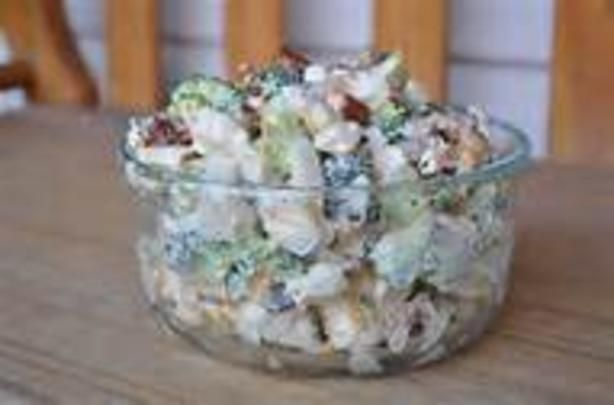 Amish Broccoli SaladAmish Broccoli Salad... This is to die for...  1 head broccoli, chopped 1 head cauliflower, chopped 1 cup mayonnaise 1 cup sour cream 1/2 cup sugar 1/2 teaspoon salt 1/2 pound bacon, fried and crumbled 1 cup shredded Cheddar cheese