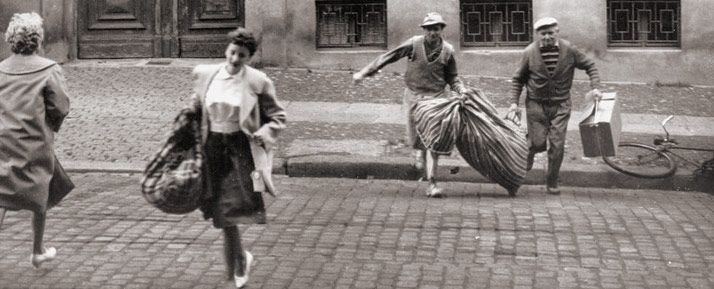 People escaping from the East side of Bernauer Strasse which was in East Berlin. The street was in West Berlin.