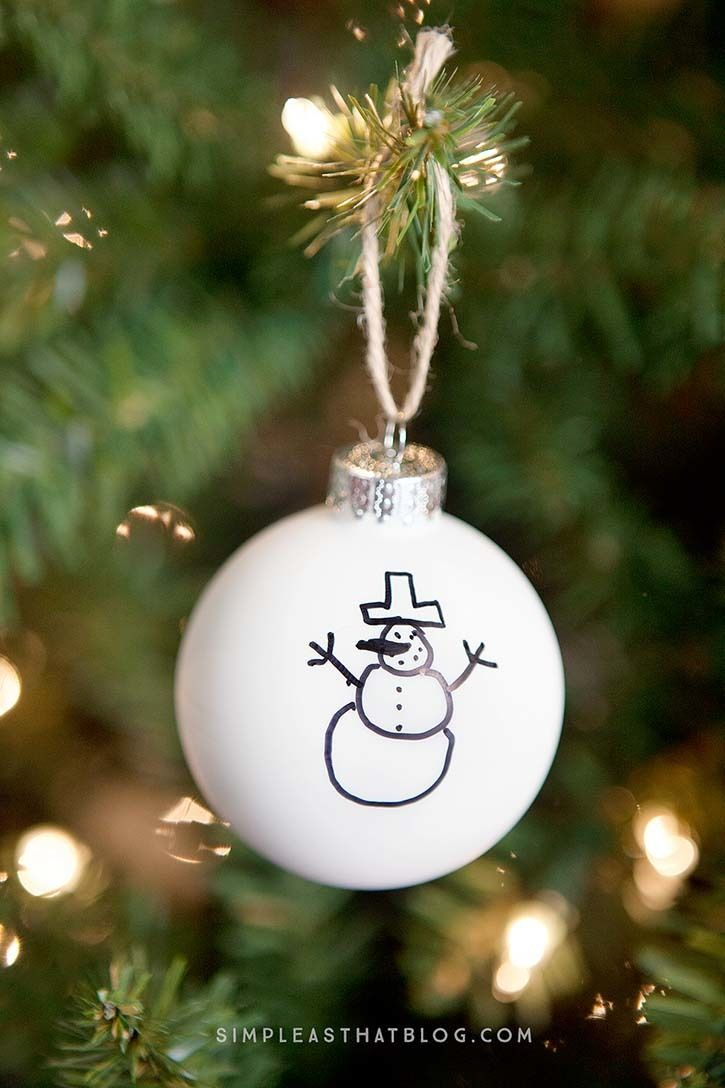 Simple Sharpie DIY Christmas Ornaments | Turn your child's beautiful artwork into a simple keepsake ornament with Sharpie crafts like this.