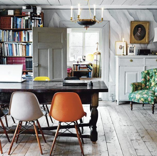 A beautifully renovated parsonage in the Swedish countryside. Love the chandelier, different colored chairs, wood floors