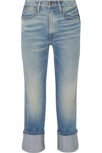 FRAME's straight-leg jeans are made from mid-weight denim. Part of the label's 'Rigid Re-Release' collection, this pair sits high on the waist and has wide folded cuffs. Wear them off-duty with sneakers.