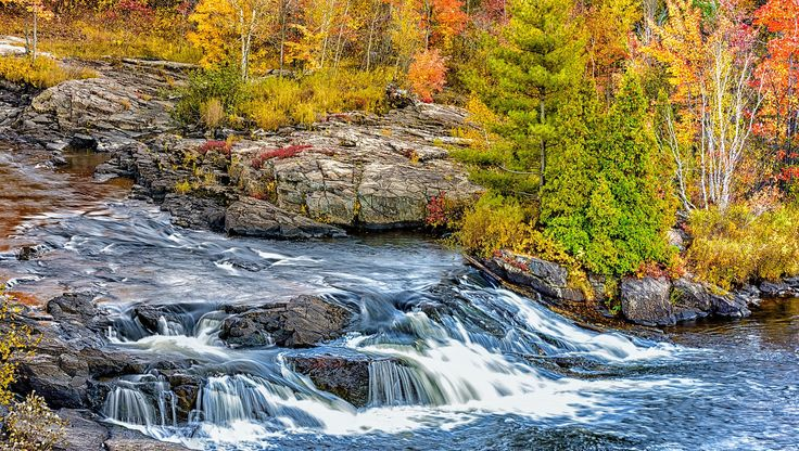 Waterfalls in Shawinigan, QC in fall colors.  Check out the stories behind each…