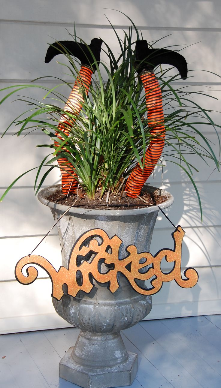 Decorating for Halloween this weekend. Don't forget your porch planters. We love these cute Wicked Witch Legs!