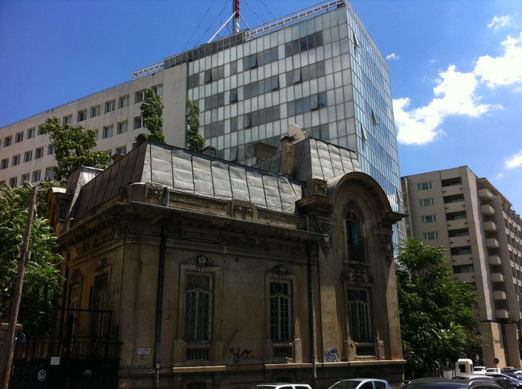 Bucharest.  Contrast of modern and French neo-classical architecture.