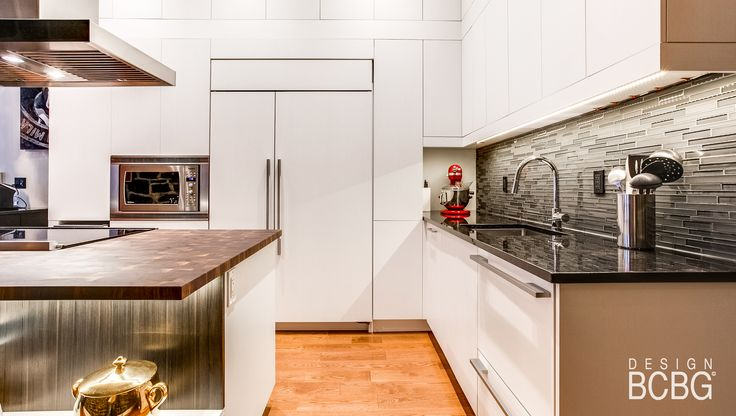 Modern kitchen style with maple cabinets painted in white lacquer.