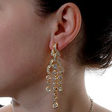 """Elegant Glow"" wearing these stunning earrings that dazzles with the beauty of Swarovski's clear crystal."