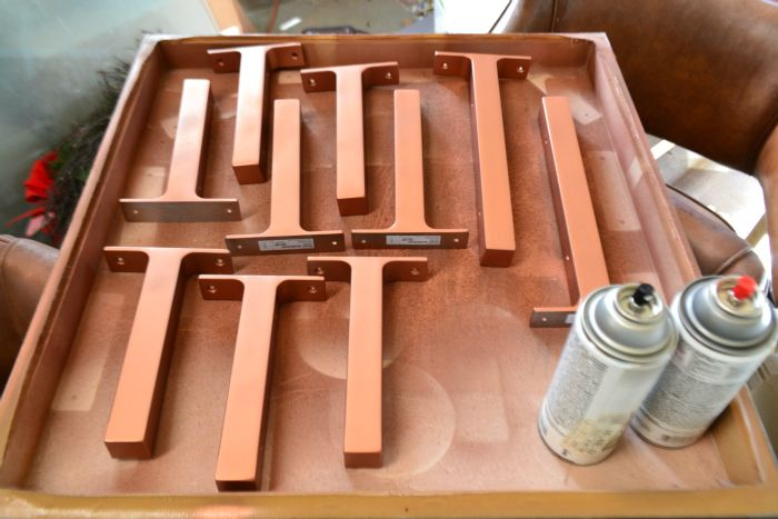 I spray painted IKEA shelf brackets with Ace Hardware's brand copper spray paint- it's my favorite copper spray paint for it's finish and color.