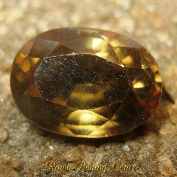 Batu Permata Alami Zircon Oval Cut Brownish Orange 2.79 carat