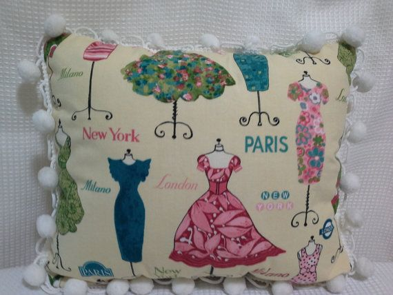 Decorative Vintage Dresses throw pillow Etsy listing at https://www.etsy.com/listing/179950853/vintage-dress-pillow-with-pom-poms