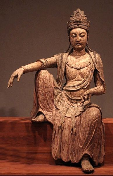 "Guanyin is the Bodhisattva associated with compassion as venerated by East Asian buddhist, usually as female. The name Guanyin is short for Guanshiyin, which means ""Observing the Sounds(or cries) of the World"""