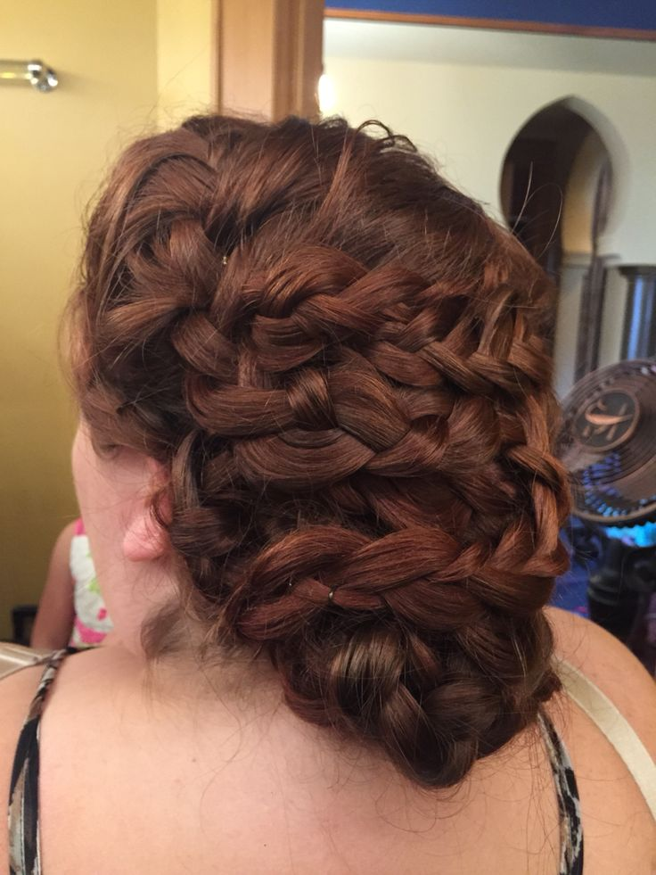 This waterfall braids is wrapped back in and turns into a Dutch braid as it goes along to create a whimsical look.