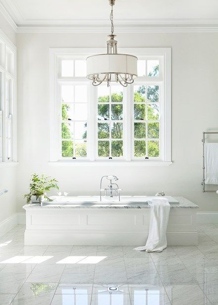 Beautiful white bathroom with dreamy tub