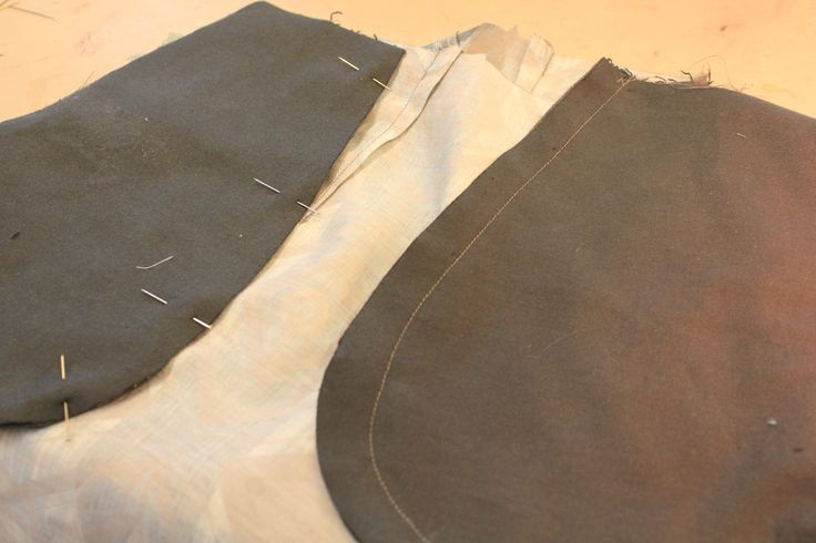 one pocket sewn, the other pinned.