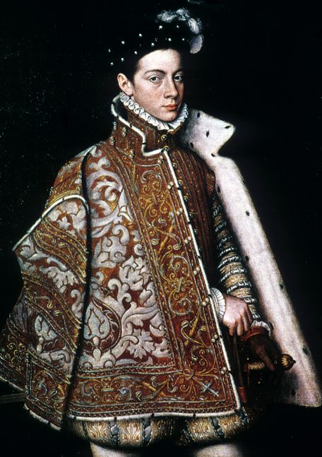 1579 16th century  Flaring short cut cape fur-lined, outdoor garment for men. Slashing in the sleeves shows through the chemise. Melon-shaped paned trunk hose. High collar surrounded by a small ruff.