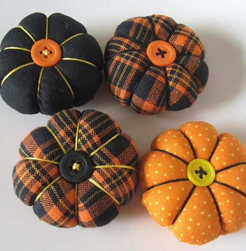 DiY cute fabric pumpkins with buttons on top. Fun fall decorating idea when you…