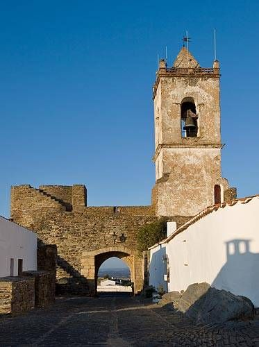 Monsaraz Picture: View of the city gate, Porta da Vila Monsaraz, Alentejo, Portugal - James Martin | About.com Europe Travel  Monsaraz is a walled village in the eastern Alentejo near Evora, on a hill fortified by the Knights Templar--the position ideal to protect Portugal from invaders from Spain. From inside the walls of Monsaraz you can see all across the Alentejo plain, across the Alqueva lakes and the River Guadiana into Spain.