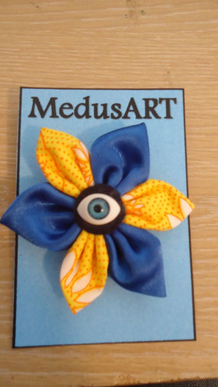 Handmade Yellow and Blue Satin Fabric Flower Brooch - $7.00. (Postage not included)  This is made to order. Please allow 1-2 days for me to make it up.  Due to pattern on fabric designs may vary slightly from the original.