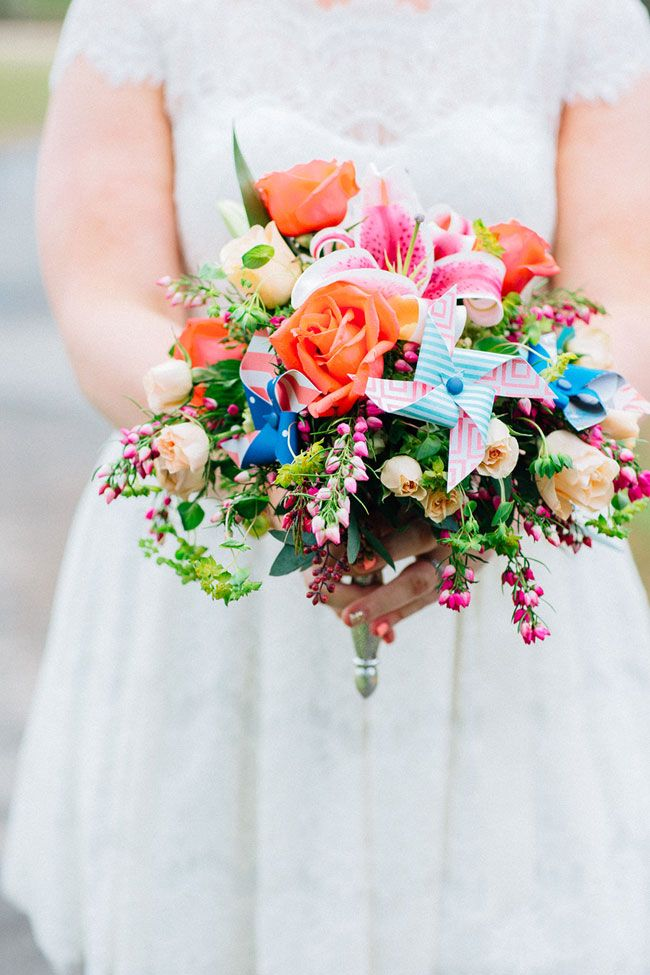 Bright rainbow bouquet with pinwheel details | Pinwheel Filled Whimsical Red Barn Wedding With Vintage Touches | Photograph by Blest Photography