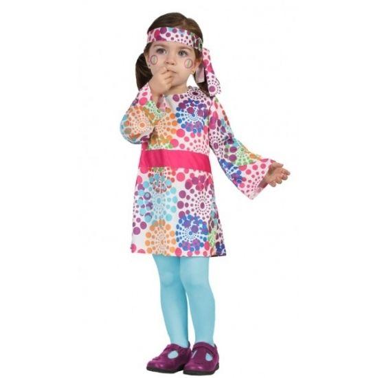 Hippie kostuum voor peuters. Het kostuum bestaat uit een jurk en bijpassende hoofdband. Materiaal: 100% polyester.
