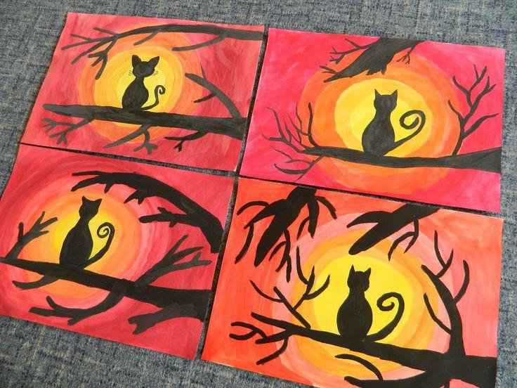 Temperovými barvami se maluje podklad - od žlutého kruhu uprostřed výkresu, postupně se barvy míchají - světle žlutá, tmavě žlutá, oranžová světlá, tmavá, lehce tužkou načrtnout kočku a hlavní větve a pak černá tempera