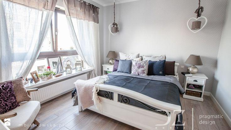 Przytulna sypialnia w szarej tonacji
