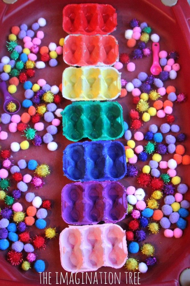 Toddler play activity pom pom colour sorting Play with colourful pom poms in the sensory table and sort them by colour into coloured egg cartons! Fine motor control, colour recognition and early sorting skills for toddlers and preschoolers.