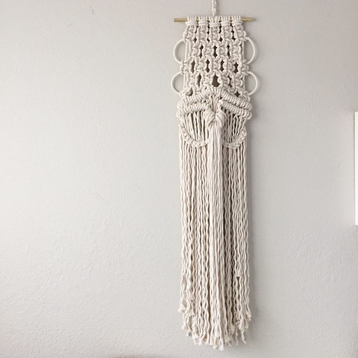 A unique macrame wall hanging that is perfect for a slim space.