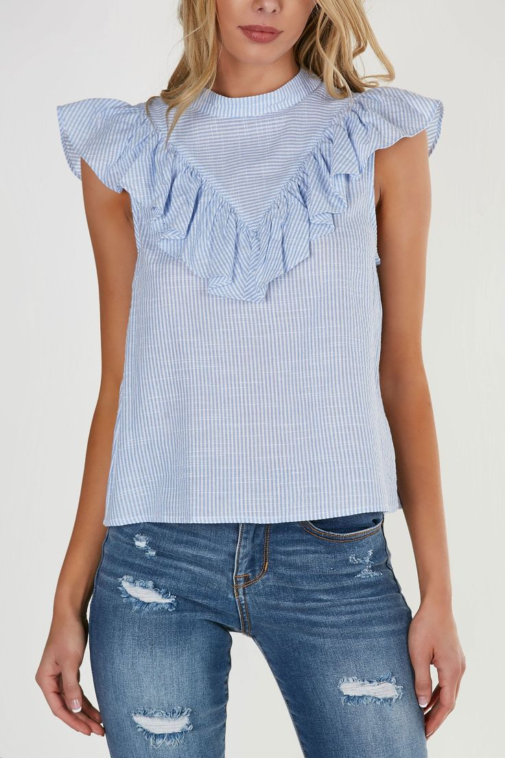 Mock neck cap sleeve blouse with stripe patterns throughout. Angled ruffle trim in front and back for added detail.
