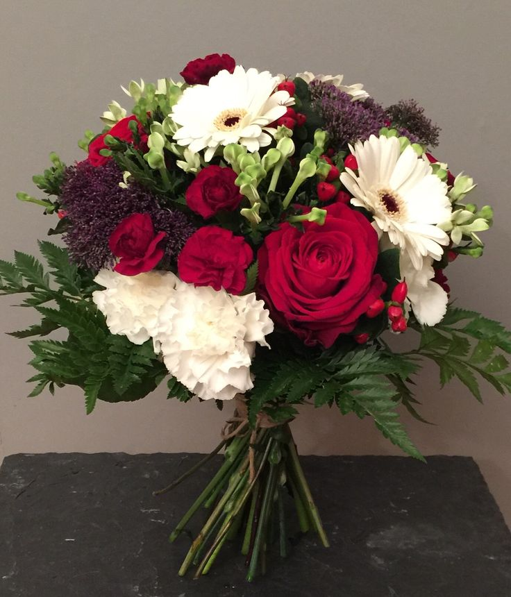 'Carol' hand tie with gerberas, roses, carnations, pistacia...